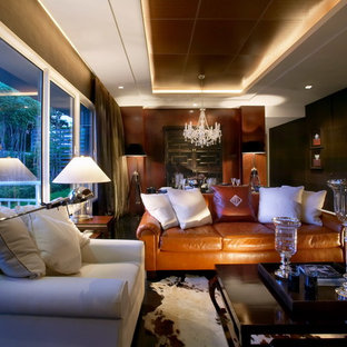 Mid-sized trendy open concept marble floor and black floor living room photo in Other with brown walls