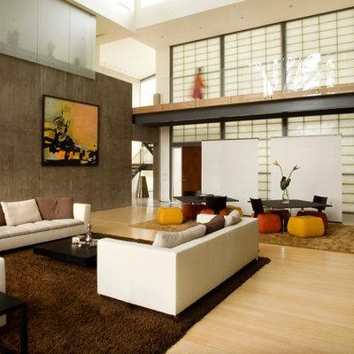 Inspiration for a modern light wood floor living room remodel in Houston