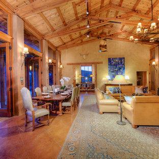 サンフランシスコの巨大なサンタフェスタイルのおしゃれなLDK (フォーマル、ベージュの壁、テラコッタタイルの床、標準型暖炉、石材の暖炉まわり) の写真