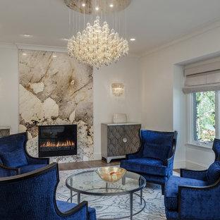 サンフランシスコの地中海スタイルのおしゃれなリビング (フォーマル、白い壁、淡色無垢フローリング、標準型暖炉、石材の暖炉まわり、テレビなし) の写真