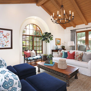 Inspiration for a mediterranean medium tone wood floor living room remodel in Orange County with white walls