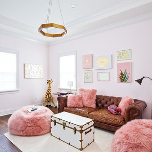 Example of a large transitional loft-style brown floor and medium tone wood floor living room design in Orlando with pink walls