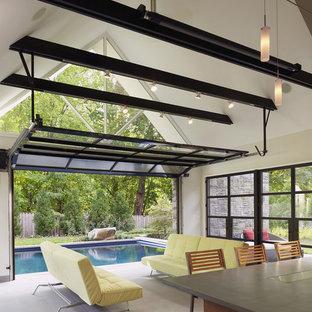 Foto di un soggiorno minimal aperto con pareti beige e pavimento in ardesia