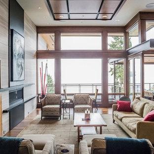 シアトルの中くらいのミッドセンチュリースタイルのおしゃれなLDK (フォーマル、グレーの壁、無垢フローリング、横長型暖炉、石材の暖炉まわり、埋込式メディアウォール、茶色い床) の写真