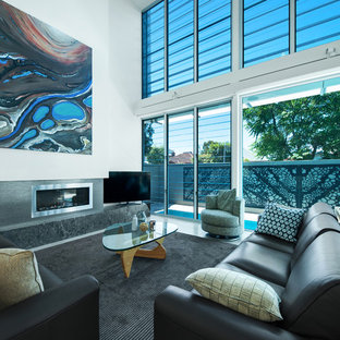 Inspiration for a contemporary open concept living room in Newcastle - Maitland with white walls, a ribbon fireplace, a stone fireplace surround and a freestanding tv.