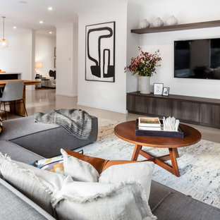 Transitional formal open concept living room in Other with white walls, a wall-mounted tv and beige floor.