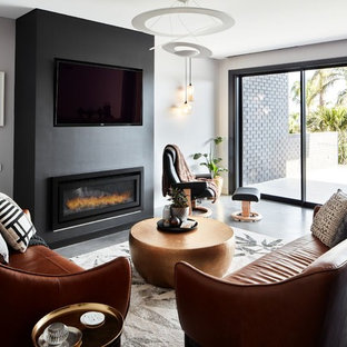 Contemporary living room in Sydney with grey walls, concrete floors, a ribbon fireplace, a wall-mounted tv and grey floor.