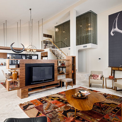 Large trendy open concept travertine floor living room photo in Perth with beige walls and a tv stand