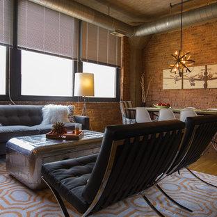シカゴの中くらいのインダストリアルスタイルのおしゃれなLDK (フォーマル、赤い壁、淡色無垢フローリング、暖炉なし、壁掛け型テレビ) の写真