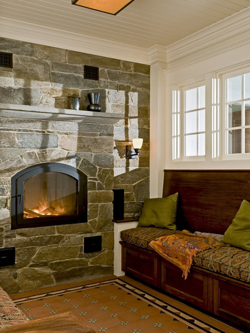Rustic Living Room Idea In Burlington With A Stone Fireplace Surround