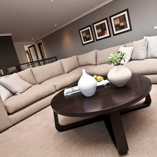 Medium sized modern formal mezzanine living room in Melbourne with brown walls and carpet.