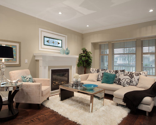 Trendy Brown Floor Living Room Photo In Vancouver With Beige Walls And A Standard Fireplace