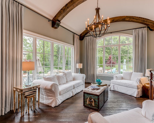 Example Of A Tuscan Enclosed Living Room Design In Other With Beige Walls Dark Wood