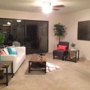 タンパの中くらいのビーチスタイルのおしゃれなLDK (ベージュの壁、カーペット敷き、ベージュの床、フォーマル、暖炉なし、テレビなし) の写真