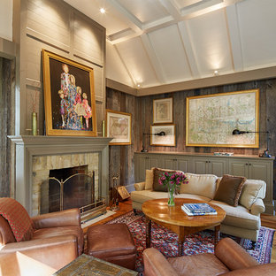 This is an example of a mid-sized country enclosed living room in DC Metro with brown walls, light hardwood floors, a standard fireplace, a plaster fireplace surround, no tv and brown floor.