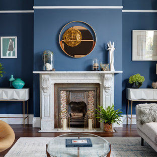 Inspiration for a large contemporary formal living room in London with blue walls, dark hardwood flooring, no tv and a wood burning stove.