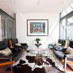 Midcentury modern brick floor living room photo in Hampshire