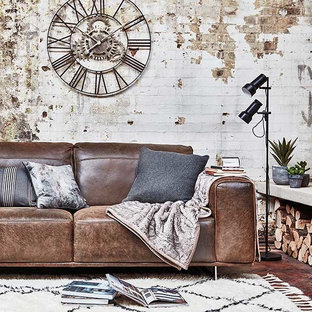 Inspiration for an expansive industrial living room in Other with white walls, dark hardwood flooring and brown floors.
