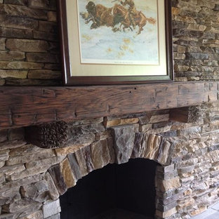 Inspiration for a medium sized rustic enclosed living room in Orlando with white walls, medium hardwood flooring, a standard fireplace, a stone fireplace surround and a wall mounted tv.