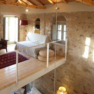 Foto di un soggiorno mediterraneo stile loft
