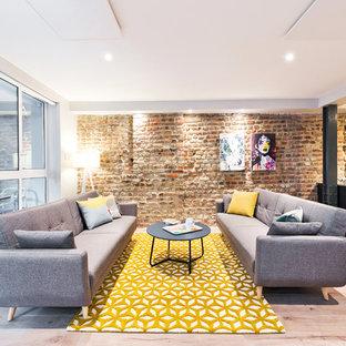 Idee per un soggiorno minimal di medie dimensioni e aperto con pavimento in laminato, nessun camino, nessuna TV, sala formale e pavimento beige