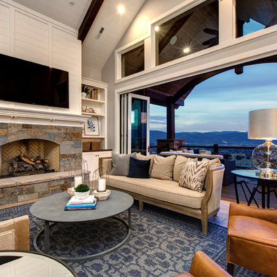 Large farmhouse open concept medium tone wood floor living room photo in Salt Lake City with white walls, a standard fireplace, a stone fireplace and a wall-mounted tv