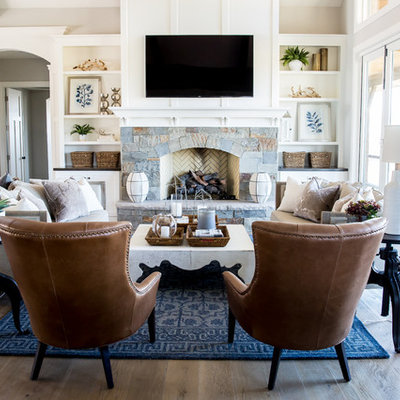 Living room - large country open concept medium tone wood floor living room idea in Salt Lake City with white walls, a standard fireplace, a stone fireplace and a wall-mounted tv