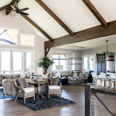 Inspiration for a large cottage open concept medium tone wood floor living room remodel in Salt Lake City with white walls, a standard fireplace, a stone fireplace and a wall-mounted tv