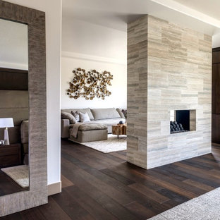 Inspiration for a huge modern enclosed porcelain floor living room remodel in Las Vegas with white walls, a two-sided fireplace, a tile fireplace and a wall-mounted tv
