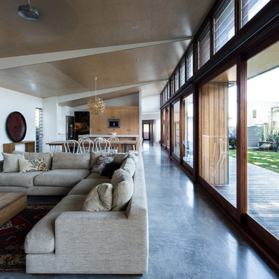 Large trendy open concept concrete floor and blue floor living room photo in Newcastle - Maitland
