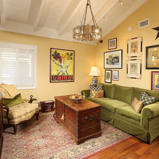 Design ideas for a mid-sized eclectic formal loft-style living room in Los Angeles with yellow walls, medium hardwood floors, brown floor, no tv and no fireplace.