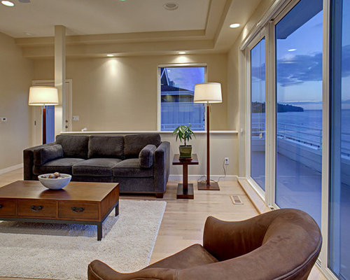 Example Of A Coastal Living Room Design In Seattle With Beige Walls