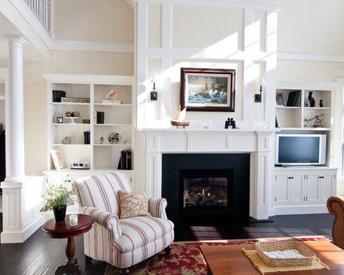Traditional Living Room Idea In Minneapolis With A Standard Fireplace Media Wall And Beige