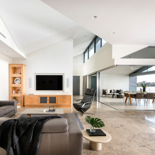 Design ideas for a contemporary open concept living room in Perth with white walls, no fireplace, a wall-mounted tv and brown floor.