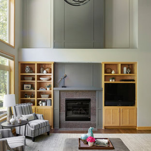 Example of a huge transitional open concept dark wood floor and brown floor living room design in Minneapolis with gray walls, a standard fireplace, a tv stand and a stone fireplace