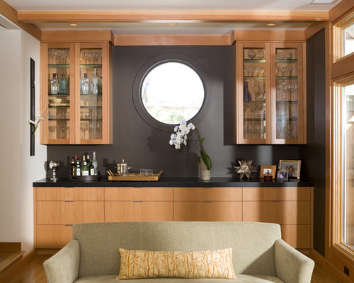 Example Of A Zen Living Room Design In San Francisco With A Bar And Black  Walls
