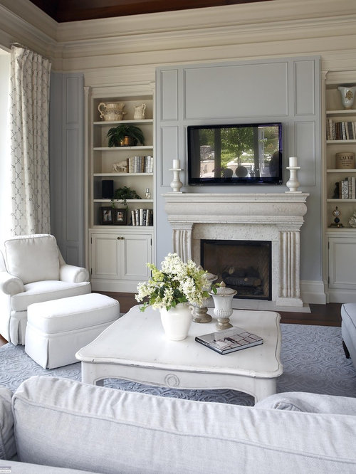traditional living room idea in burlington with blue walls and a wall