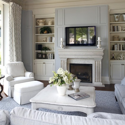 Living room - traditional living room idea in Burlington with blue walls and a wall-mounted tv