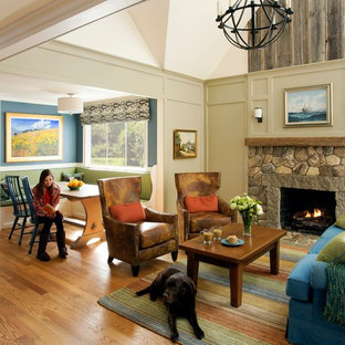 Mid-sized open concept medium tone wood floor living room photo in Boston with green walls, a standard fireplace and a stone fireplace