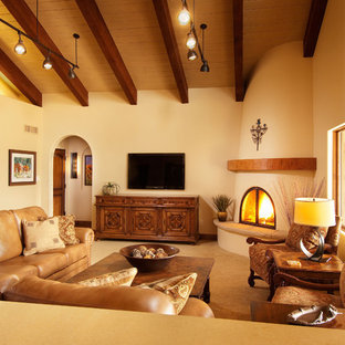 Inspiration for a large transitional open concept carpeted living room remodel in Phoenix with a corner fireplace, a wall-mounted tv, beige walls and a plaster fireplace