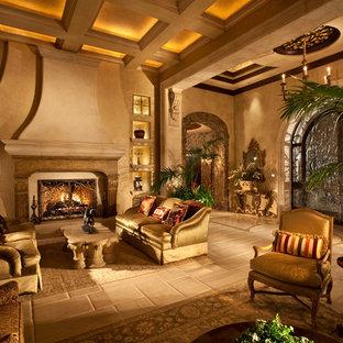 ラスベガスの広い地中海スタイルのおしゃれなLDK (フォーマル、ベージュの壁、磁器タイルの床、標準型暖炉、テレビなし、石材の暖炉まわり) の写真