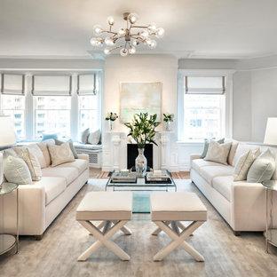ニューヨークの大きいトランジショナルスタイルのおしゃれなLDK (フォーマル、白い壁、カーペット敷き、標準型暖炉、木材の暖炉まわり、壁掛け型テレビ、ベージュの床) の写真