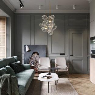 Foto de salón panelado, clásico, panelado, sin chimenea, con paredes grises, suelo de madera clara y panelado