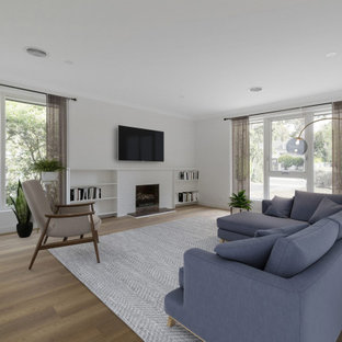 Photo of a modern living room in Melbourne with white walls, medium hardwood floors, a standard fireplace, a brick fireplace surround and brown floor.