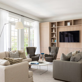 Example of a large transitional open concept light wood floor and brown floor living room design in Miami with white walls and a wall-mounted tv