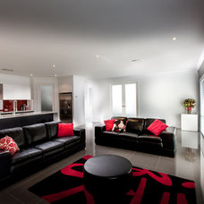 Modern Living Room by Quality Constructions