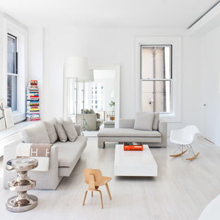 Inspiration for a scandinavian living room in New York with white walls, light hardwood flooring, no fireplace and white floors.