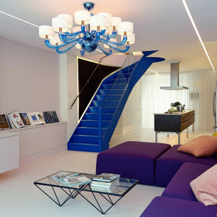 Inspiration for a living room in London with pink walls, concrete flooring and pink floors.