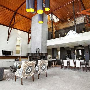 Idéer för ett modernt vardagsrum, med kalkstensgolv