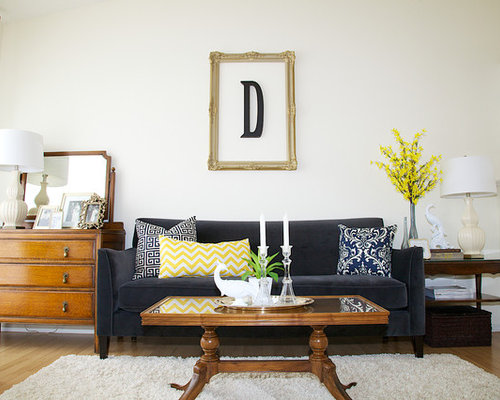 Example of a mid-sized trendy medium tone wood floor living room design in  Other